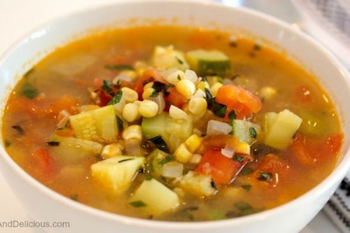 Vegetable soup with corn, zucchini and tomatoes